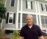 Danny Lipford standing in front of completed two-story addition on historic home.