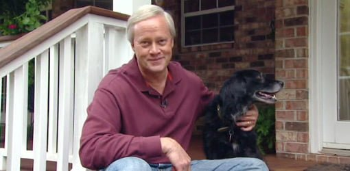Danny Lipford on porch with dog.