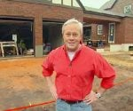 Danny Lipford standing in front of the Kuppersmith project house garage.