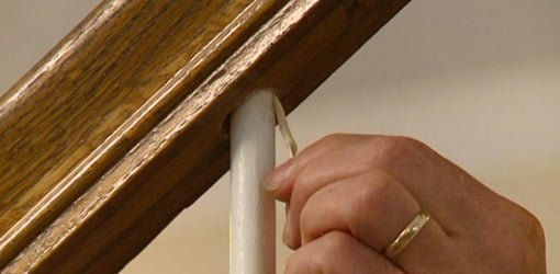 Repairing a loose staircase baluster spindle using a toothpick and wood glue.