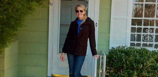 First time homeowner, Chelsea Lipford, in front of her new house.