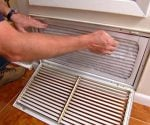 Changing air filter on central air conditioner.