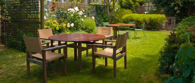 Table and chairs on lawn in yard.