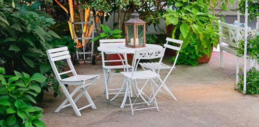 Table and chairs on a patio.