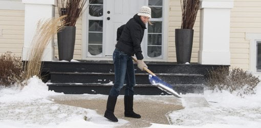 Shoveling snow on sidewalk