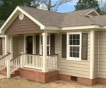 House with new vinyl siding and trim.
