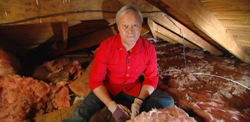 Danny Lipford in insulated attic of house.