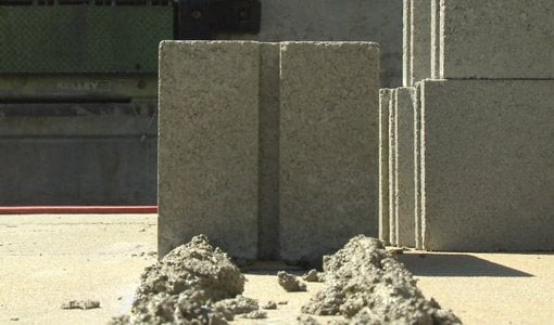 Concrete block laid on footer.