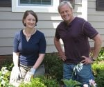 Julie Day Jones and Danny Lipford planting shrubs.