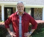 Danny Lipford standing in front of house in need of repair.
