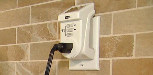 Ryobi Power Usage Meter plugged into electrical wall outlet.