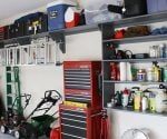 Completed garage organization project with new shelving and storage.