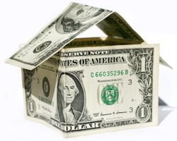Dollar bills in the shape of a house.