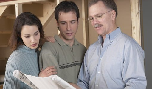 Homeowners and contractors checking plans.