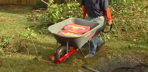 Hauling bags of concrete in the True Temper Poly Wheelbarrow with Total Control Handles