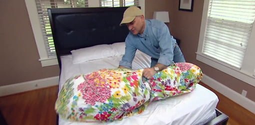 Joe Truini demonstrating his trick for putting a duvet cover on a comforter.