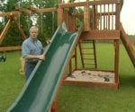 Danny Lipford with outdoor wooden playset.