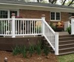 Completed composite deck, steps, and railing added to back of house.