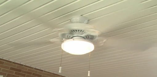 Paddle ceiling fan mounted on porch.