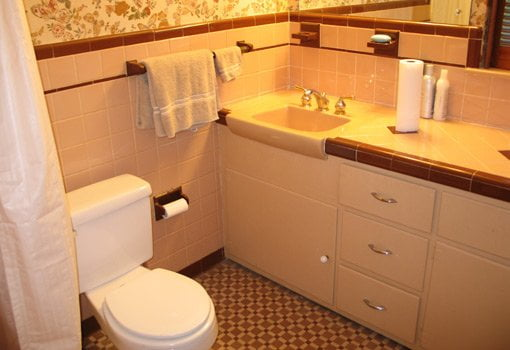 Dated bathroom with brown tile before remodeling.