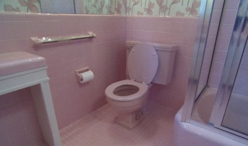 Pink tile bathroom and toilet.