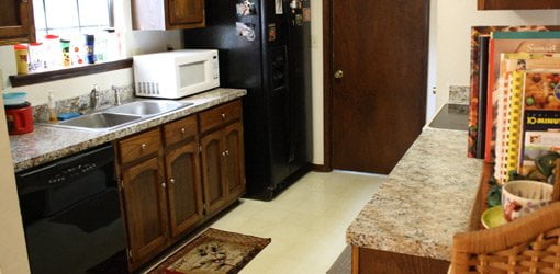 Minor kitchen makeover included refinishing cabinets and countertops.