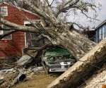 Take photos of the storm damage, and file an insurance claim as soon as possible.