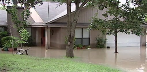 House with flood water in yard after hurricane.