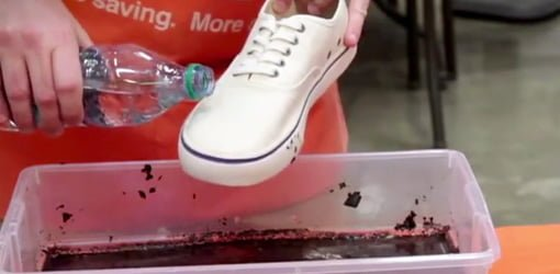 Water runs off a shoe treated with Rust-Oleum NeverWet liquid repellant spray.