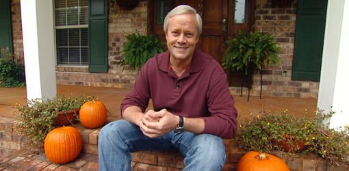 Danny Lipford on front porch of house with pumpkins.