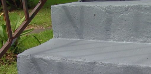 Concrete steps after applying textured concrete coating.