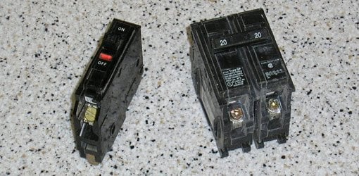 Single and double 20-amp circuit breakers.