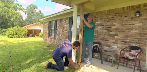 Homeowner Hunter Black and Danny Lipford jacking up rotten porch columns.