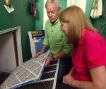 Danny Lipford showing homeowner E.A. Keeble how to change an air filter.