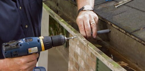 Replacing a loose gutter spike with a gutter screw.