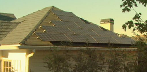 Solar panels generating electricity on the roof of a home.