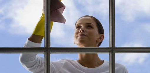 Cleaning glass on windows in spring.