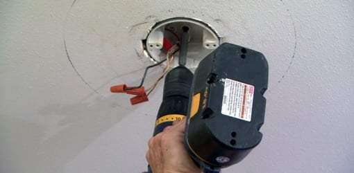 Attaching a ceiling electrical box to a wood support.