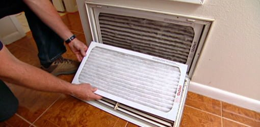 Changing air filter on central heating/cooling unit.