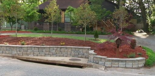 Completed DIY stackable block retaining wall.