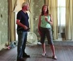 Esther de Wolde and Danny Lipford examine the ceiling in the historic Ford house.