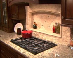 Kitchen cooktop built into stone countertop.