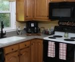 Remodeled kitchen with new solid surface countertops and faucet.