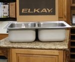 Elkay Magna double bowl kitchen sink sitting on countertop.