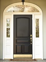 Entry door with glass sidelights and transom.