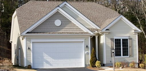 House with white garage door.