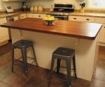 Kitchen with new island and solid walnut countertop.