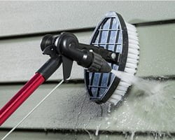 Cleaning siding on house with Hyde PivotPro Water Wand.