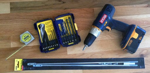 Tape measure, drill bits, cordless drill, and turnbuckle.
