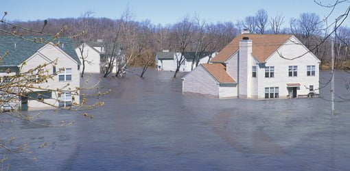Houses under water in a flooded neighborhood.